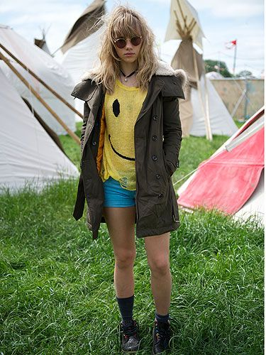 <p>The model (who has been lucky enough to be linked to Bradley Cooper) posed in an array of outfits although this has to be our favourite simply because of the blue Hudson Jeans shorts and yellow jumper! The look was pulled together with a khaki jacket and circular shades – effortlessly cool.</p>