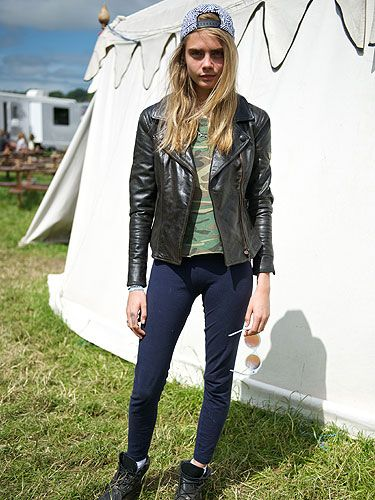 <p>Day four of Glasto saw model of the moment emerge in yet another amazing ensemble, this time she ruled the fields in navy leggings with a camouflage t-shirt worn under a simple biker jacket given a pop of personality thanks to a backwards baseball cap.</p>