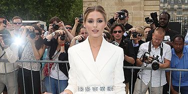 <p>Oh, Olivia Palermo, how we love you so! She proved her fashion prowess yet again, this time at the Christian Dior Haute Couture runway show in Paris.</p> <p>Wearing the label head-to-toe, the star looked simply stunning in a belted white blazer and a shimmering organza  skirt. Simple and chic. Swoon!</p>