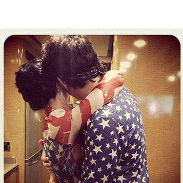 <p>Katy Perry and John Mayer look adorable in this picture Katy Instagrammed on 4th July. At least we think it's John, we can't be completely sure. The two lovebirds are cuddling and wearing his 'n' hers American flag outfits. Cute.</p>