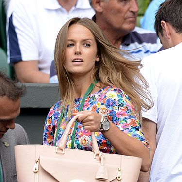 <p>As an aspiring artist, Kim Sears clearly has an eye for a painterly floral, and her frock to watch Andy Murray take on Russia's Mikhail Youzhny in the fourth round at Wimbledon was no excpetion.</p><p>HOWEVER. Our eyes were frimly on the prize - in this case her lovely £1,5000 Mulberry Willow handbag. You might gasp at the price, but Kim has certainly been getting bang for her buck, toting it at every match throughout the tournament.</p><p>No wonder victory was in the bag for Andy, eh?</p>
