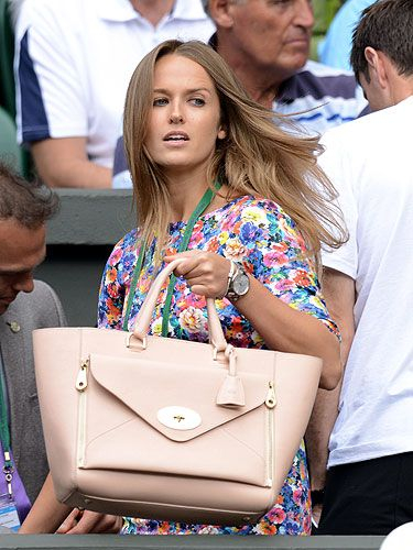 <p>As an aspiring artist, Kim Sears clearly has an eye for a painterly floral, and her frock to watch Andy Murray take on Russia's Mikhail Youzhny in the fourth round at Wimbledon was no excpetion.</p> <p>HOWEVER. Our eyes were frimly on the prize - in this case her lovely £1,5000 Mulberry Willow handbag. You might gasp at the price, but Kim has certainly been getting bang for her buck, toting it at every match throughout the tournament.</p> <p>No wonder victory was in the bag for Andy, eh?</p>