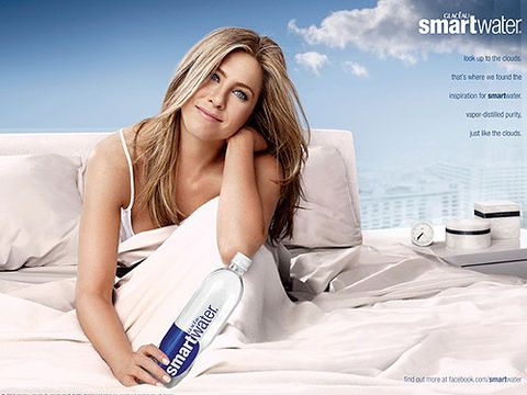 <p>How predictable is this Jennifer Aniston smartwater advert? Are we supposed to believe that she's woken up looking this perfect? That she sleeps in a lush-looking bed overlooking New York City? Duh, of course we are – because she probably <em>does</em>. This is Jennifer Aniston we're talking about, after all. The latest ad sees JenAn perched on a bed (sans Justin Theroux) dressed in a white vest top with a coy grin - oh, and great hair (natch!). The only thing we don't buy is the naff looking alarm clock, she definitely wouldn't own <em>that</em>. </p>