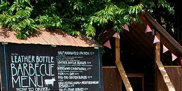 """<p>The Leather Bottle boasts one of the biggest - and best - beer gardens in London.</p> <p>Tucked away in Garratt Lane in South West London, and perfect for lazy summer lunching, thanks to the lush BBQ sizzling all season, our favourite spot to park ourselves for an afternoon of alfresco fun, are the brand new beach huts - complete with bunting. It's almost as if we're beside the seaside, not Earlsfield...</p> <p><a title=""""The Leather Bottle"""" href=""""http://www.leatherbottlepub.co.uk"""" target=""""_blank""""><em>leatherbottlepub.co.uk</em></a></p>"""