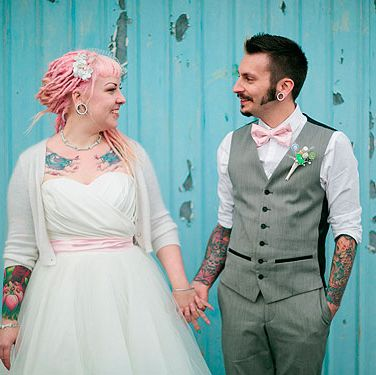 "<p>""Skip & Soya put so many personal touches into their back garden wedding… and it shows. From the kitsch and quirky centrepieces to the origami cranes, pom poms, ribbon wands and button bouquets. This was a Rock n Roll wedding to remember.""</p>