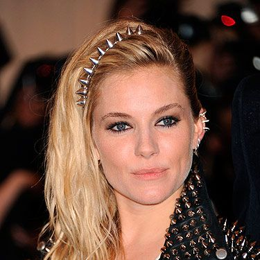 <p>The Met Gala's punk theme brought all sorts of ear cuffs to the red carpet. Sienna gave her rock look some extra edge with a host of silver ear cuffs to go with her silver spikes.