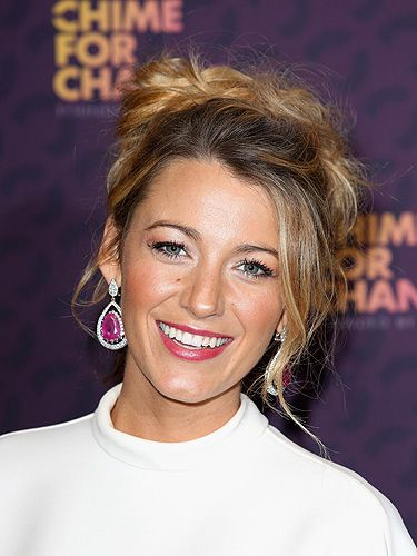 <p>Blake's messy updo is effortlessly cool, and it's the rough finish that prevents the style from looking too 'prom'. Copy by backcombing your locks and sweeping them into a knot, pin to secure and accessorise with killer earrings.</p>