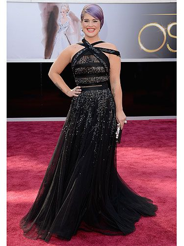 <p>You can tell Kelly Osbourne co-hosts a fashion show, the girl works some serious style on the red carpet! Kelly was one of the first to arrive at The Oscars 2013 – no doubt to score outfits for the Fashion Police. Kelly was shimmering in a stunning black Tony Ward Couture dress with crystal detail. She decided to pile on the glam with diamond Norman Silverman earrings and a black Judith Leiber bag while styling her lilac hair in a sleeked-down do.</p>
