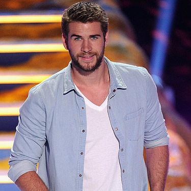 <p>Liam Hemsworth presented the award for Choice Movie Actress: Comedy to Rebel Wilson on stage at the 2013 Teen Choice Awards. We are so jealous of Rebel – she was in such close proximity to the Hunger Games actor, we'd probably faint. Seriously, look at how beautiful his face is. Miley Cyrus, we salute you.</p>