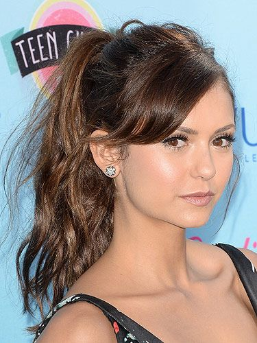 """<p>Nina Dobrev kept things simple with a messy updo. The actress worked a loose high ponytail complete with a face framing side fringe. Casual but perfect! Check out more easy summmer updo's <a title=""""http://www.cosmopolitan.co.uk/beauty-hair/news/styles/celebrity/20-easy-summer-updo-ideas?click=main_sr"""" href=""""http://www.cosmopolitan.co.uk/beauty-hair/news/styles/celebrity/20-easy-summer-updo-ideas?click=main_sr"""" target=""""_blank"""">here.</a></p>"""