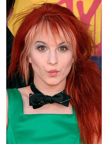 <p>Hayley switched things up with a blonde layer underneath her auburn red hair. We love her messy side ponytail on the red carpet at the 2008 MTV Video Music Awards.</p>