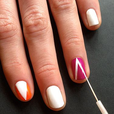 <p>On the orange and purple painted nails paint on a triangle with the striping brush in white polish. Vary the direction of the triangle on each nail, so, place one triangle pointing towards the tip on one nail and a triangle pointing to the cuticle on another.</p>