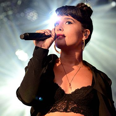 """<p>This girl is on fire right now - 2013 is definitely her year! Jessie Ware is heading to V Festival to sing her soulful tunes – and we'll be watching!<br /><br /><strong>So, who is she?</strong><br />South Londoner Jessie Ware is a singer-songwriter. After finishing University, Jessie performed as a backing singer for her friend Jack Peñate. It was on Jack's US tour that she discovered the music of SBTRKT, which catapulted her to stardom.<br /><br /><strong>Do I know her?</strong><br />Duh! Yes. Try not getting Wildest Moments stuck in your head.<br /><br /><strong>I love her, how do I find out more?</strong><br />Her website<a title=""""http://jessieware.com/"""" href=""""http://jessieware.com/"""" target=""""_blank""""> Jessieware.com </a>is as cool as she is!</p>"""