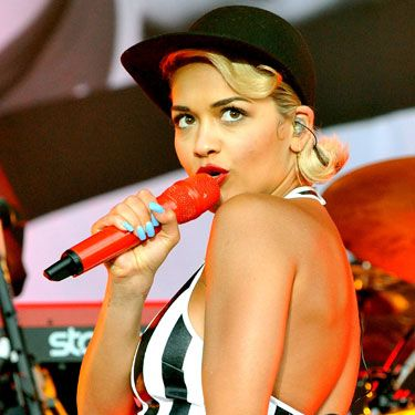 <p>Ms Ora went for the monochrome trend with just the right addition of an American vibe as she teamed a striped halter neck with a baseball cap and even managed to match her red microphone to her lipstick – that's our sort of girl.</p>