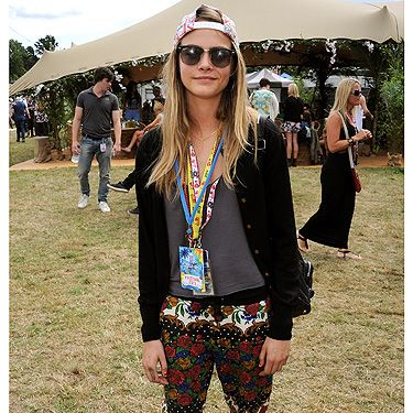 <p>Model of the moment (when <em>will</em> it be time stop saying that?) Cara Delevingne rocked her trademark tomboyish off-duty look in jazzy patterned pants by MinkPink, a leather jacket, hi-tops and a backwards baseball cap. She even managed to make her lanyards look like a fashion statement.</p>
