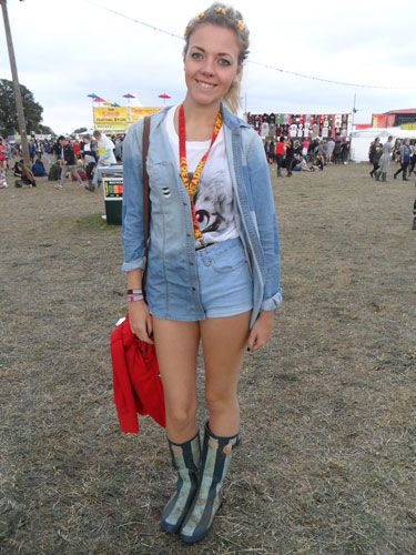 <p>Promoting fashion's fight for double denim to hit the mainstream was Bethany, 19 who partied in denim shorts and a matching shirt worn over a cute kitten t-shirt. For a final flourish she wore striped wellies and a floral headband.</p>