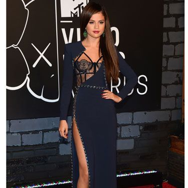 Selena Gomez went for a raunchy Versace dress with a thigh-high split and underwear-as-outerwear glimpse of a basque.
