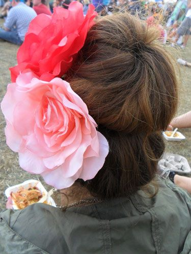 <p>A big, tousled bun is a definite festival winner. Using a hair donut can give the illusion of voluminous, blow-dried locks, when secretly they're just covered in dry shampoo and you want them away from your neck.</p> <p>Two giant flowers make for an extra touch of fun.</p>