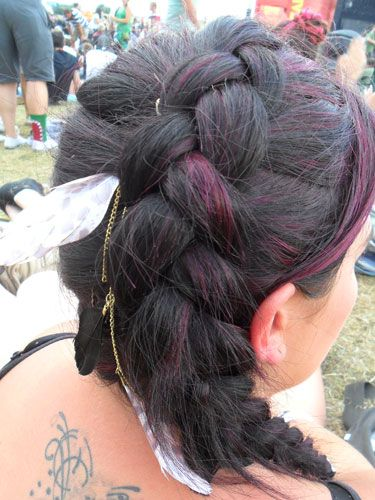 <p>Plaits are back in a very big way, and this thick braid caught our attention at Reading this year. We're loving the lighter coloured streaks that are woven through the braid, and wearing it on the side of your crown is a new take on an old classic.</p> <p>Also, nice feather.</p>