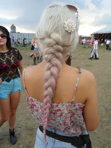 <p>What a pretty plait; this gal's hair has been loosely swept into a long braid, and the subtle dip-dye that fades into pink is a perfect look for a festival.</p> <p>Another little flower accessory makes this plait a boho-dream. Vanessa Hudgens would be jealous.</p>