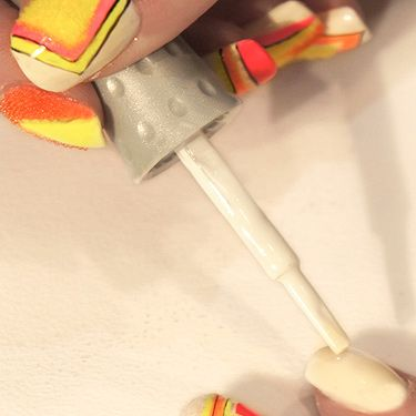 <p>After applying a base coat, apply two coats for white on each nail.</p>
