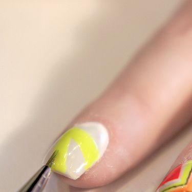 <p>Use the yellow nail polish to create a chevron.</p>