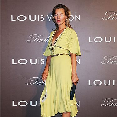 "<p><a href=""http://cosmopolitan.co.uk/fashion/news/kate-moss-kaftan-holiday-style"" target=""_blank"">Kate Moss</a> showed off her tan at the Louis Vuitton 'Timeless Muses' exhibition in Tokyo. Wearing a yellow rhinestone-studded bell-sleeved dress by Louis Vuitton (who else?) and grey LV sandals, we thought the model positively glowed with glamour.</p>
