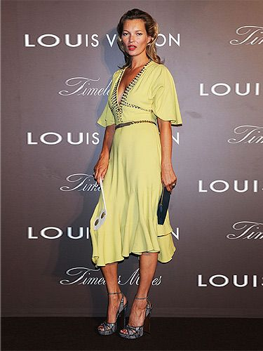 "<p><a href=""http://cosmopolitan.co.uk/fashion/news/kate-moss-kaftan-holiday-style"" target=""_blank"">Kate Moss</a> showed off her tan at the Louis Vuitton 'Timeless Muses' exhibition in Tokyo. Wearing a yellow rhinestone-studded bell-sleeved dress by Louis Vuitton (who else?) and grey LV sandals, we thought the model positively glowed with glamour.</p> <p><a href=""http://www.cosmopolitan.co.uk/fashion/love/love-it-or-loathe-it-kate-moss-yellow-dress"" target=""_blank"">DO YOU LOVE OR LOATHE KATE'S LOOK? VOTE!</a></p> <p class=""fb_frame_side_right_paragraph""><a href=""http://www.cosmopolitan.co.uk/fashion/shopping/new-in-store-27-august#fbIndex1"" target=""_blank"">SHOP THIS WEEK'S BEST NEW BUYS</a></p> <p class=""fb_frame_side_right_paragraph""><a href=""http://www.cosmopolitan.co.uk/fashion/news/"" target=""_blank"">SEE THE LATEST FASHION NEWS</a></p>"