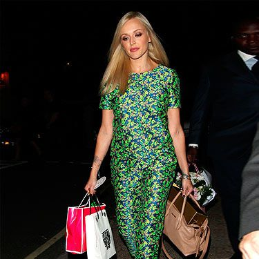 "<p>Not only is <a href=""http://cosmopolitan.co.uk/fashion/news/WATCH-Fearne-Cotton-shows-off-post-baby-body-as-she-models-new-AW13-collection-for-Very"" target=""_blank"">Fearne Cotton</a> BACK filming Celebrity Juice (sha-TING!), she's back in the fashion game with this bang on trend get-up. We LOVE her 60s-inspired fitted floral ensemble from Boutique By Jaeger, styled to perfection with black sandals and a chic Miu Miu nude tote.</p>