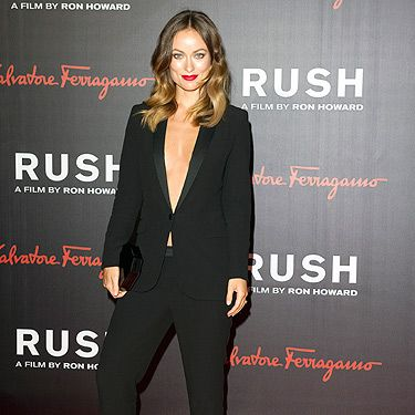 <p>Olivia Wilde got pulses racing in her sexy Gucci suit and statement red lipstick for the premiere. Suzy Miller – her character/stunning model – Suzy Miller would be proud.</p>