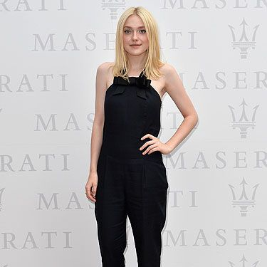 "<p><a href=""http://www.cosmopolitan.co.uk/fashion/news/dakota-fanning-venice-film-festival"" target=""_blank"">Dakota Fanning</a> goes for the double with another wow-worthy look, this one daytime appropriate, at Venice Film Festival portrait session at the <span>Terrazza Maserati.</span> She rocks 90s minimalism with her sleek 'n' chic black Viktor & Rolf jumpsuit teamed with illusion<span> heels and smoky eyes.</span></p>
