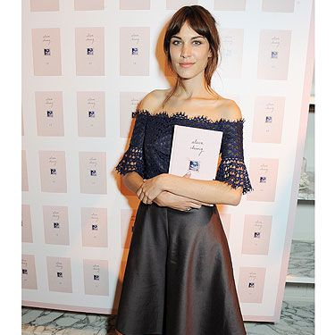 <p>Alexa Chung looked cute in a Carven dress and preppy flats at the London launch of her first ever book (which she also used as an accessory).</p>