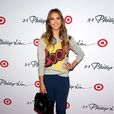 <p>Jessica Alba looked casully coolat the Phillip Lim for Target launch party in NYC. Wearing a playful slogam sweater with navy-and-black tuxedo trousers, then finished with a black structured bag from the collection, the actress looked BOOM-diggity.</p>