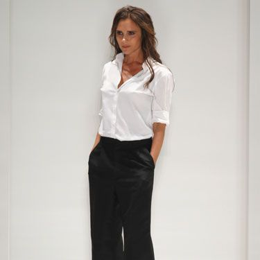 """<p>Victoria Beckham brought her Spring/Summer 2014 collection to New York Fashion Week for its debut today (with <a href=""""http://www.cosmopolitan.co.uk/fashion/news/david-beckham-harper-nyfw"""" target=""""_blank"""">David and Harper Seven watching from the frow</a>), and showed clean lines and masculine tailoring.</p><p>She said that """"the interpretation of shapes"""" was her starting point this season, and that she's """"set boyish elements against a sense of femininity"""" for the collection.</p><p>Click through to see the (really actually very wearble) line from VB, and let us know what you think in the comments box below, or on Twitter at <a href=""""victoria%20beckham%20debuts%20fashion%20collection%20in%20new%20york%20for%20nyfw%20-%20victoria%20beckham%20designer%20clothes%20images%20-%20cosmopolitan.co.uk"""" target=""""_blank"""">@CosmopolitanUK</a></p>"""