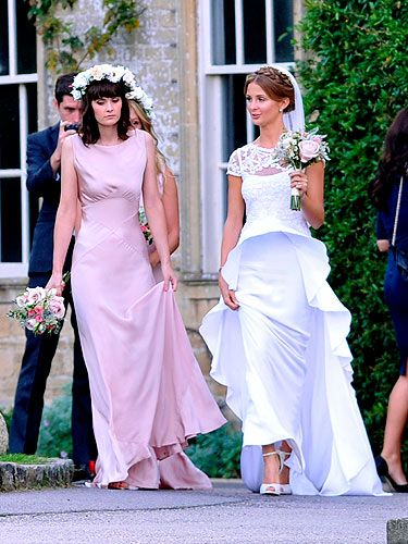 <p>Millie Mackintosh with her one of her bridesmaids - model and Dirty Sexy Things star Charlotte De Carle</p>