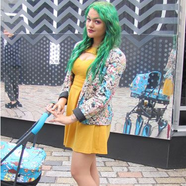 Dying your hair green is brave. Teaming it with a floral jacket, yellow dress, red shoes and bold make-up is medal worthy. Say hello to alternative model, Becky Cremer!
