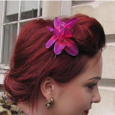 We love this rocking rich shade of red, and the lily behind the quiff gives it an elegant touch.