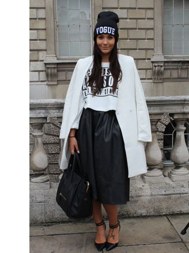 Beanie hat, sleek white crombie coat, leather midi: who said monochrome was dull? Love how she's mixed a slogan tee and bold, graphic beanie with the classic shapes of the skirt and coat.