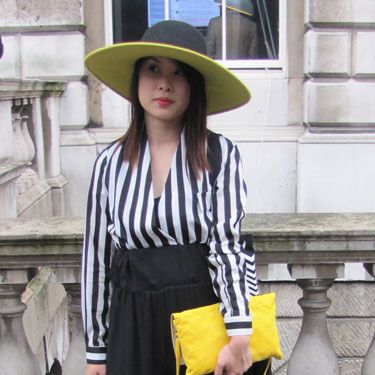 We adore this look! The yellow accessories give this monochrome outfit serious fashion cred.