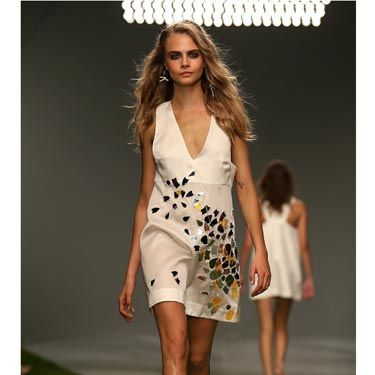 <p>Cara closed the show in this mosaic-embellished cream dress. </p>