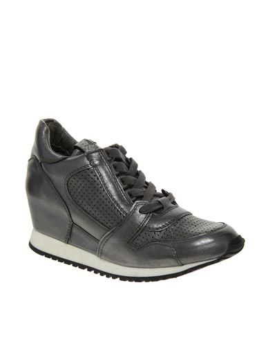 "<p>Nail two trends in one with these pewter hidden wedge trainers. Wear with heavy metal jewellery for maximum impact.</p> <p>Wedge trainers, £165, Ash at <a href=""http://www.asos.com/Ash/Ash-Dean-Metallic-Hidden-Low-Wedge-Trainers/Prod/pgeproduct.aspx?iid=3130567&SearchQuery=metallic&sh=0&pge=0&pgesize=36&sort=-1&clr=Metal"" target=""_blank"">ASOS</a></p> <p> </p>"
