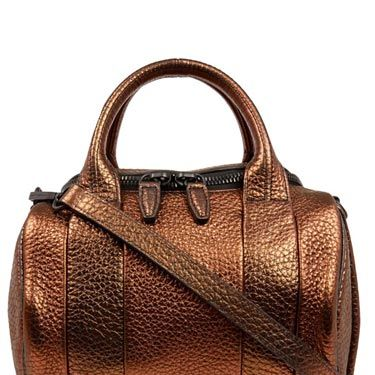 """<p>A fashion week favourite and spotted on all of our favourite celebs, this Alexander Wang bronze Rockie bag is one super statement handbag.</p><p>Bronze Rockie bag, £650, Alexander Wang at <a href=""""http://www.liberty.co.uk/fcp/product/Liberty/BAGS/Brown-Rockie-Metallic-Pebble-Leather-Bag/90776"""" target=""""_blank"""">Liberty</a></p><p> </p>"""