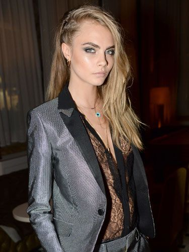 <p>Cara took the trouser suit to a new level, pairing it with a sexy lace plunge shirt at the W Magazine party which celebrated Cara's September cover. </p>