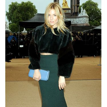 Sienna Miller rocked up with her tousled blonde locks caught slightly in the London GALE that took the city by (a literal) storm before the show kicked off, looking chic in a pencil skirt and cropped furry jacket.