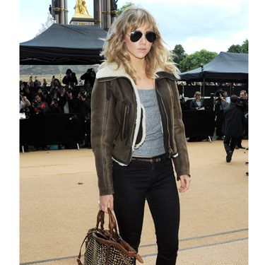 Suki Waterhouse's laid-back cool was epitomised with her shearline coat, grey vest and skinnies as she arrived at Kensington Gardens. Loving her studded bag, too.