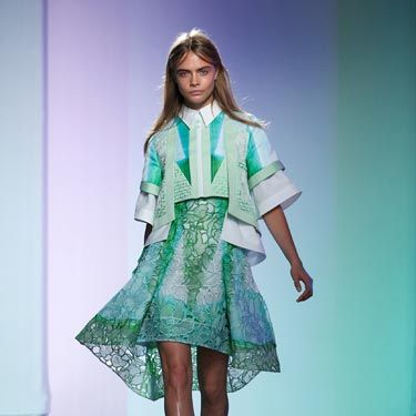 <p>Cara looked every bit a spring girl as she opened the Peter Pilotto show, wearing pastel greens and blues in a signature Pilotto look, with multi-layers and stiff white collar. </p>