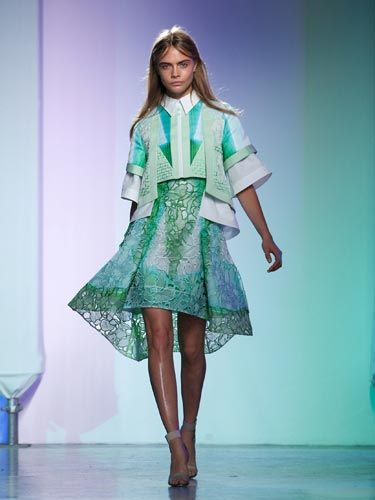 <p>Cara looked every bit a spring girl as she opened the Peter Pilotto show, wearing pastel greens and blues in a signature Pilotto look, with multi-layers and stiff white collar. </p> <p> </p>
