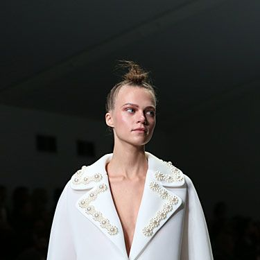 Oversized collars were big business in her collection. We love!