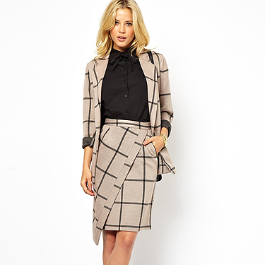 """<p>""""When does the Hitchcockian trend work best? I'd say definitely in the 'sexification' of workwear'. Nothing oozes sophistication more than this season's skirt suits – fitted-to-the-body tailored jackets and longline pencil skirt – or a shift dress cinched at the waist. Simply add a pair of classic court shoes and you're good to go.""""</p><p><strong>Shelly Vella, Cosmopolitan's Fashion & Style Director</strong></p><p>Check wrap skirt (£40) and blazer (£60), <a href=""""http://www.asos.com/ASOS/ASOS-Pencil-Skirt-with-Wrap-in-Check/Prod/pgeproduct.aspx?iid=3299707&sgid=6853&cid=15189&sh=0&pge=0&pgesize=-1&sort=-1&clr=Multi"""" target=""""_blank"""">asos.com</a></p><p><a href=""""http://www.cosmopolitan.co.uk/fashion/shopping/winter-fashion-trend-2013-checks"""" target=""""_blank"""">CHECK MATE: SHOP THE WINTER TREND</a></p><p><a href=""""http://www.cosmopolitan.co.uk/fashion/shopping/winter-fashion-trend-2013-punk"""" target=""""_blank"""">FEELING PUNKY? SHOP THE WINTER TREND</a></p><p><a href=""""http://www.cosmopolitan.co.uk/fashion/news/"""" target=""""_blank"""">GET THE LATEST FASHION AND STYLE NEWS</a></p>"""