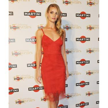 "<p>As to be expected, <a href=""http://www.cosmopolitan.co.uk/fashion/love/love-it-or-loathe-it-rosie-huntington-whiteley-martini-gala"" target=""_blank"">Rosie HW</a> oozed sex and sophistication at Martini's 150th Anniversary Gala held at Villa Erba overlooking the sensational Lake Como. Her siren-red fitted dress, fifties-inspired <a href=""http://www.cosmopolitan.co.uk/beauty-hair/news/styles/celebrity/cosmo-hairstyle-of-the-day"" target=""_blank"">hair</a> and signature red lip stole the show. </p>"